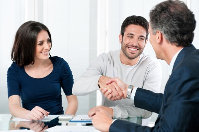 image of business partners meeting with insurance agent