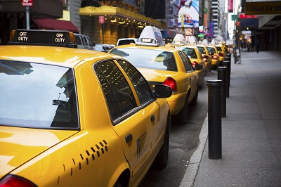 image of yellow cabs parked curbside