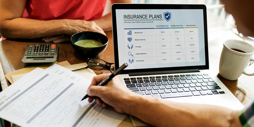 image of man on computer looking at insurance plans