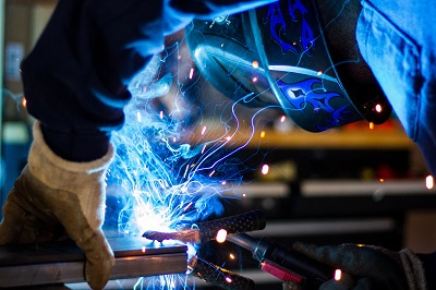 image of welder working in manufacturing plant